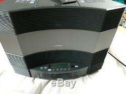 Presenting THE BOSE ACOUSTIC WAVE MUSIC SYSTEM II with connective 5 CD CHANGER